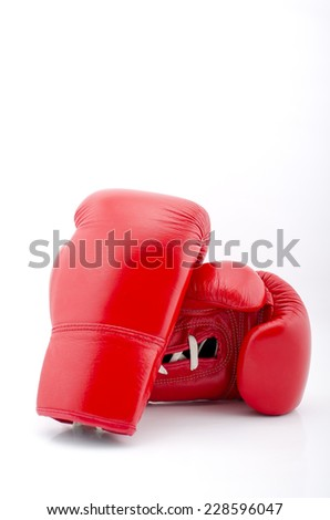 pair of red boxing gloves on a white background. - stock photo