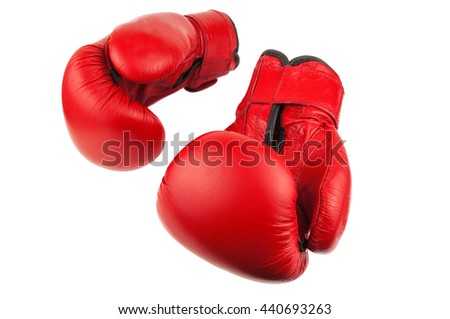 pair of red boxing gloves on white background - stock photo