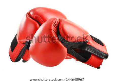 Pair of red leather boxing gloves isolated on white - stock photo