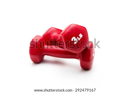 Pair of red rubber-coated dumbbells isolated on white background - stock photo