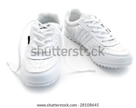 pair of running shoes over the white background - stock photo
