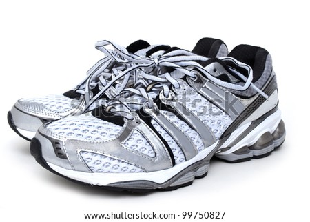 pair of running shoes white background - stock photo