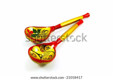 Pair of russian wooden spoons isolated on white - stock photo
