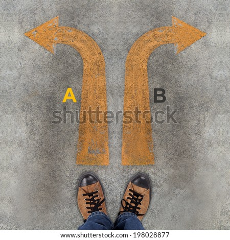 Pair of shoes and two arrows with A, B - stock photo