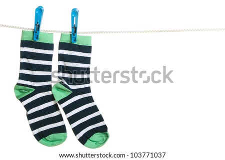 Pair of striped socks hanging on the clothesline. Image isolated on white background - stock photo