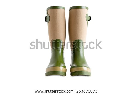 Pair of stylish ladies gardening boots, gumboots or wellington boots made of green and beige waterproof rubber, isolated on white - stock photo