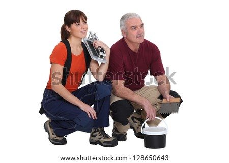 Pair of tilers - stock photo