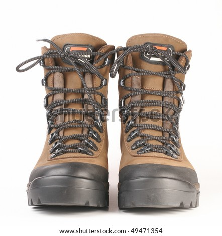 Pair of tourist boots on a white background - stock photo