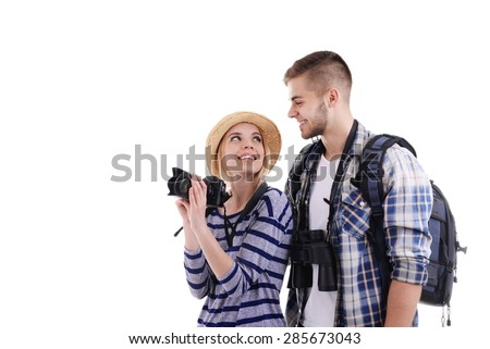 Pair of travelers with camera isolated on white - stock photo