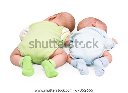 Pair of twins lying on a stomach - stock photo