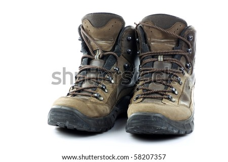 Pair of used hiking shoes on a white background - stock photo
