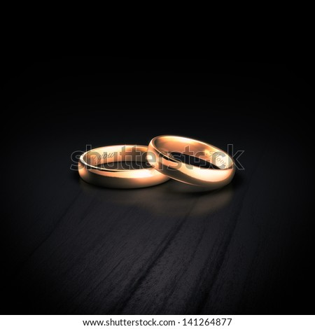 Pair of wedding rings with inscriptions - stock photo