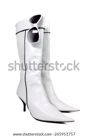 Pair of white boots over white - stock photo