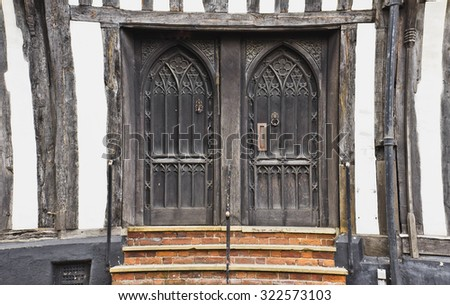 Pair of wooden doors in an old english building - stock photo