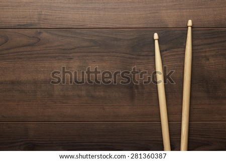 pair of wooden drumsticks on wooden table - stock photo