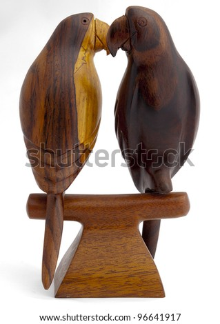 pair of wooden parrots - stock photo