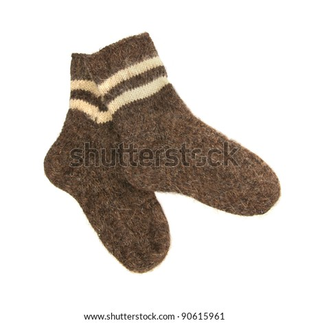 pair of woolen warm socks isolated on white - stock photo