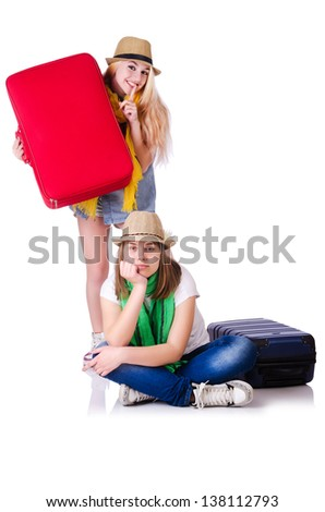 Pair of young students travelling - stock photo