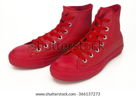 Pair red hightop sneakers on white background - stock photo