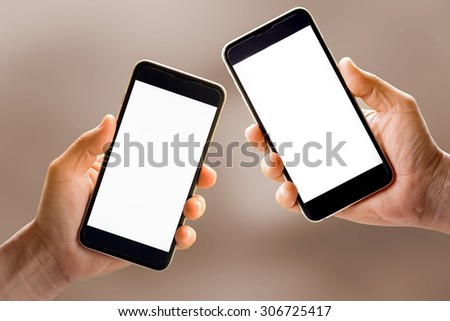 Pairs hands holding smartphone device. - stock photo
