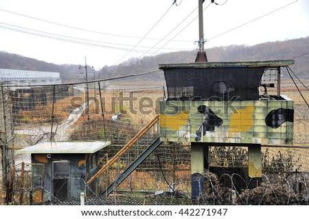 PAJU, SOUTH KOREA- NOVEMBER 14: DMZ Zone (South Korea): South Korean soldiers guarding by the Freedom Bridge watching border, November 14, 2015 Paju, South Korea - stock photo