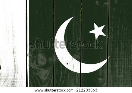 Pakistan flag on wooden background  - stock photo