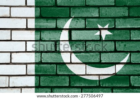 Pakistan flag painted on old brick wall texture background - stock photo