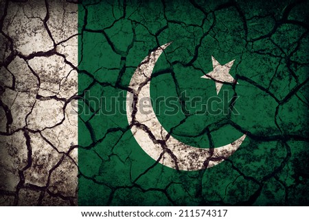 Pakistan flag pattern on the crack soil texture ,retro vintage style - stock photo