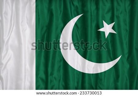 Pakistan flag pattern on the fabric texture , vintage style - stock photo
