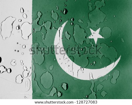 Pakistan. Pakistani flag covered with water drops - stock photo