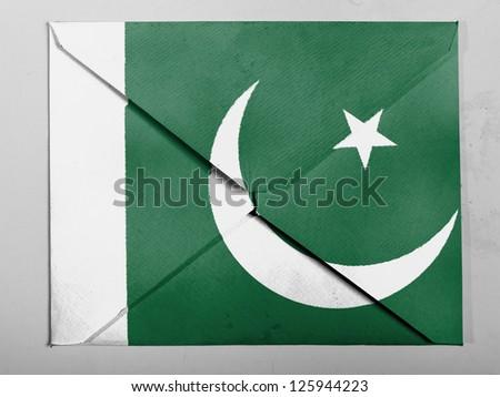 Pakistan. Pakistani flag painted on grey envelope - stock photo