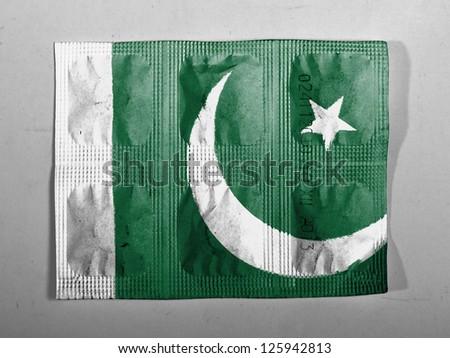 Pakistan. Pakistani flag painted on pills - stock photo