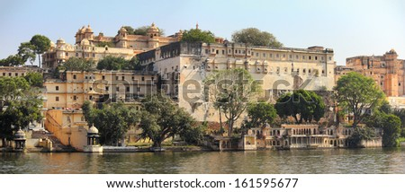 palace and lake in Udaipur India - view from boat - stock photo