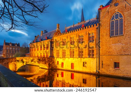 Palace of the Liberty of Bruges and the Green canal, Groenerei at night, Belgium - stock photo