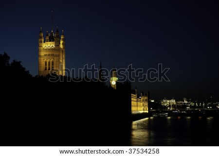 Palace of Westminster and the River Thames, London, England, UK, Europe, at night. - stock photo