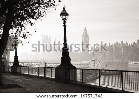 Palace of Westminster in fog seen from South Bank  - stock photo
