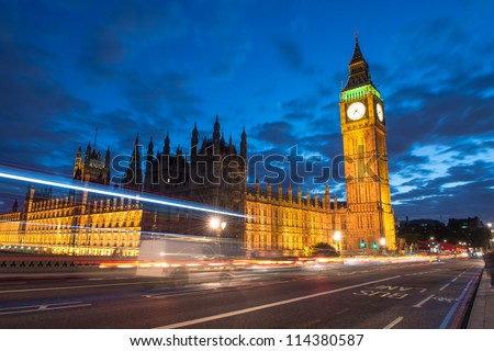 Palace of Westminster with Big Ben seen from Westminster Bridge at Night - London - UK - stock photo