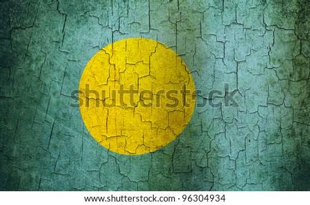 Palau flag on a cracked grunge background - stock photo