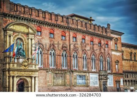 Palazzo D'Accursio under dramatic sky in Bologna, Italy - stock photo