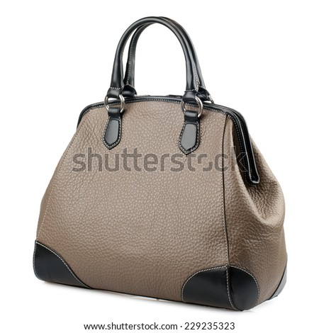 Pale brown female leather handbag isolated on white background  - stock photo
