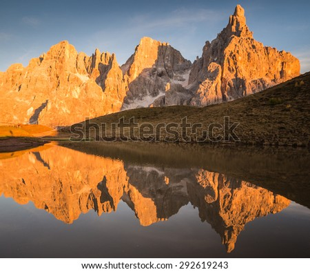 Pale di San Martino, Trentino Alto Adige, Italy. The Pale group reflecting itself in a mountain lake during sunset. - stock photo