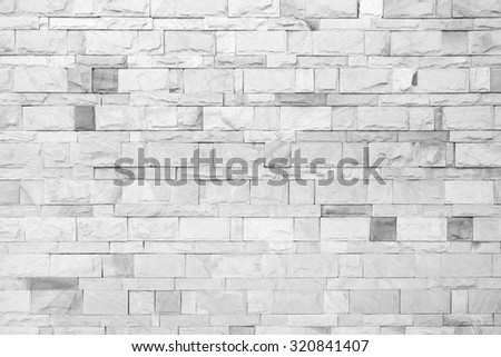Pale gray aged vintage brick wall fine arranged - stock photo