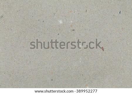 Pale grey cardboard texture. Grey background. - stock photo
