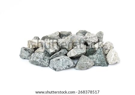 Pale of crushed stone isolated on white - stock photo