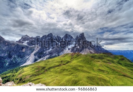 Pale San Martino against the sun from Rolle pass, Italian Dolomites - HDR image - stock photo