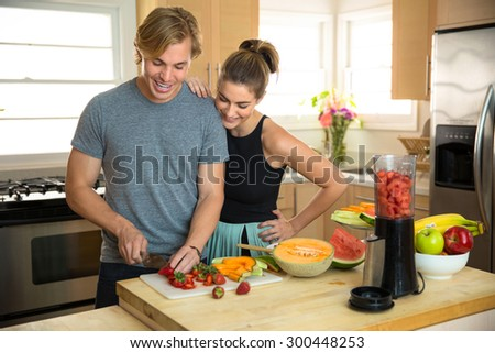 Paleo diet fruits nuts and veggies vegan lifestyle couple share a healthy nutritional lunch snack smoothie - stock photo