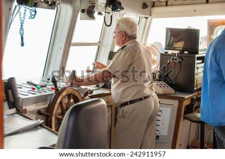 PALEOCHORA, CRETE, GREECE - SEPTEMBER 22, Nautical bridge on the ferry to Agia Roumeli and to the island Gavdos on September 22, 2014. The Captain is on the bridge - stock photo