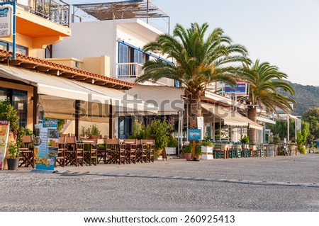 PALEOCHORA, CRETE, GREECE - SEPTEMBER 20. The beach promenade in Paleochora on September 20. 2014. Paleochora is a nice village in the south of Crete. Plenty of tourists spend their vacation here - stock photo