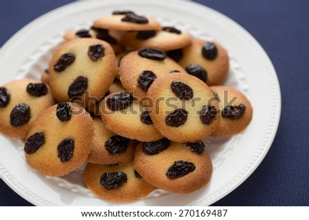 Palets aux raisins - french recipe for raisin thin biscuit cookies, made of plain egg-white batter - stock photo