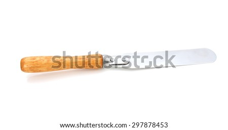 Palette knife with a wooden handle, isolated on a white background - stock photo